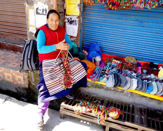 Tibetan lady selling hand made souvenirs in McLeod Ganj, Dharamsala, India