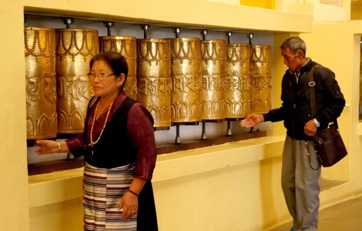 the Tibetans turning prayer wheels in the Dalai Lama temple, McLeod Ganj, Dharamsala, India